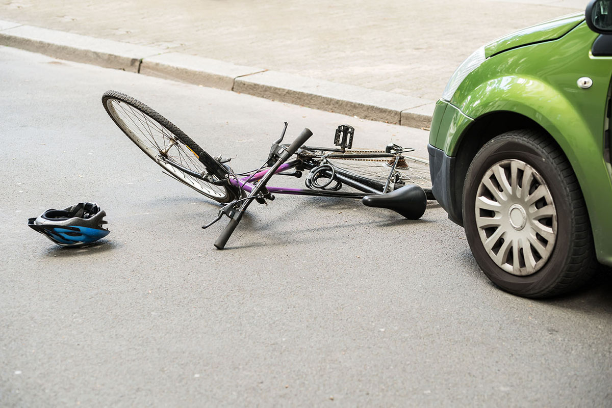 A bike was hit with a car.